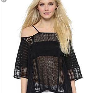 Free People black echo poncho sweater. Size large